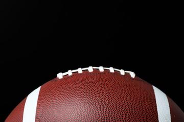 New leather American football on chalkboard, closeup