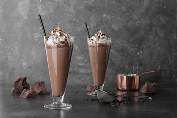 Aluminium Prints Milkshake Glasses with chocolate milk shakes on grey table