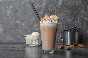 Fotobehang Milkshake Glass with delicious milk shake on table