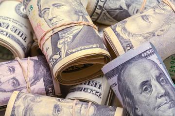 Rolls of Money In Pile