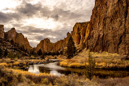 A river running through a valley with large rock formations on either side, Oregon