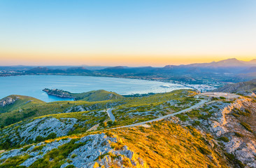 Sunset aerial view of Pollenca bay with Port de Pollenca and Alcudia towns, Mallorca, Spain