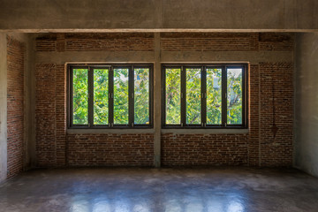 Antique wooden window with the old brick wall in classic room