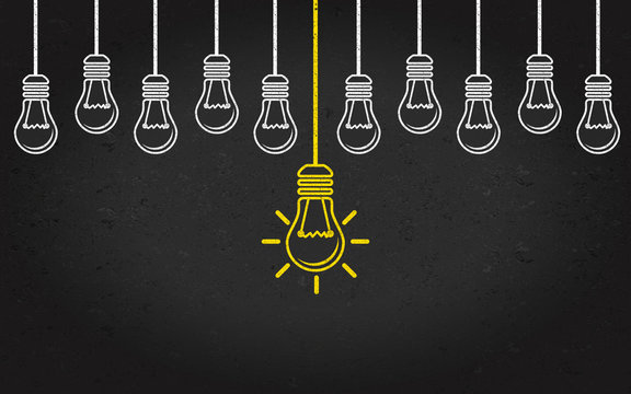 Light bulbs on a blackboard background. Creativity concept with innovation or inspiration in business, thinking outside the box.Strategy and leadership on teamwork. Opportunity, solution and success.