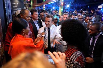 French President Emmanuel Macron arrives at the Afrika Shrine nightclub in Nigeria's commercial capital Lagos