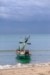 Fishing boats landing at the coast. During the strong sea breeze.
