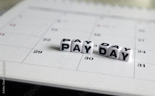 A White Cube Arranged In The Word Pay Day On The Calendar Stock