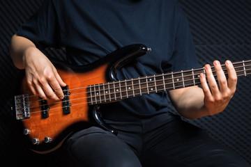 Rock bass guitarist practicing.