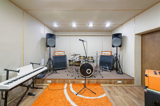 Sound rehearsal studio room with drum kit.