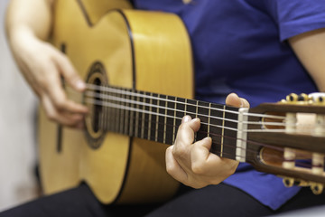 Playing spanish guitar.