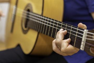Playing spanish guitar.