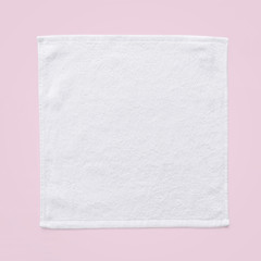 White cotton towel mock up template square size fabric wiper isolated on pastel pink background with clipping path, flat lay top view