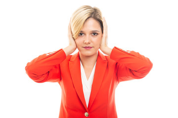 Young pretty business woman covering ears gesture.