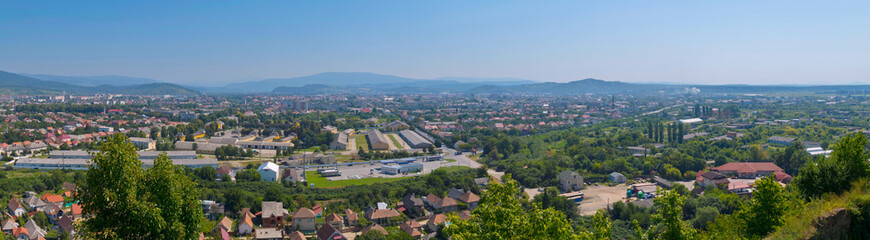 a magnificent panorama of the city with a beautiful nature lying in a green mountain valley