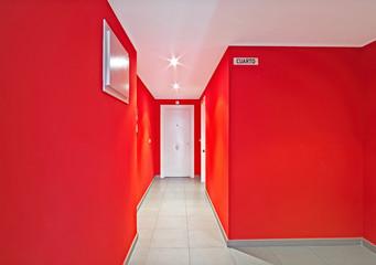 Doors in red corridor