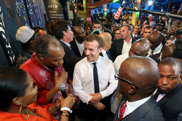 French President Emmanuel Macron arrives to take part of a live show at the Afrika Shrine in Lagos
