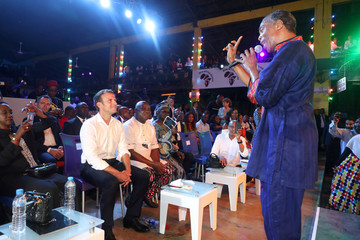 French President Emmanuel Macron watches Nigerian musician Femi Kuti as he performs at the Afrika Shrine in Lagos