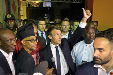 French President Emmanuel Macron arrives to take part of a live show in the Afrika Shrine in Lagos