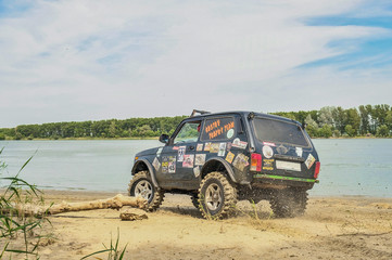 car sport off-road truck participates in the competition for dirt and sand