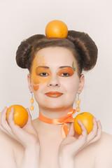 Beautiful girl with oranges. Portrait, female.