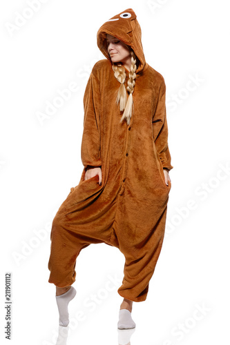 A pretty girl with braids in a funny kigurumi featuring poop