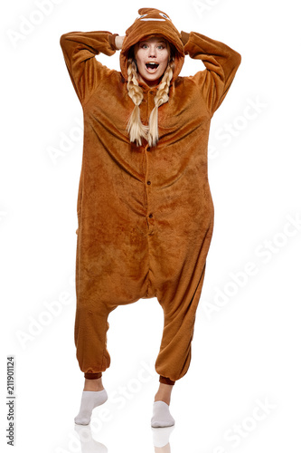 A pretty girl in a funny brown kigurumi featuring poop emoji