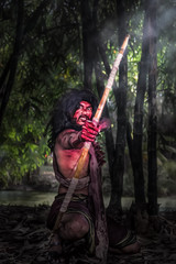 acting image legnt of Angulimala who was famous bandit in India old time before became monk and finally Buddhist saint in Buddhism, selective focused with dark tone
