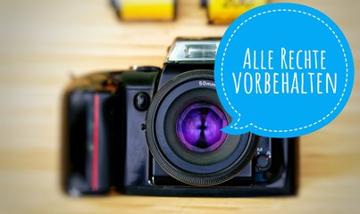 Camera with in german Alle Rechte vorbehalten in english All rights reserved