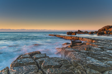 Sunrise and Rock Platform by the Sea
