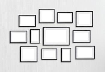 Black wooden photo frames collage, twelve units set mock up on textured wall, 3d illustration