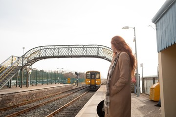 Woman standing at railway station
