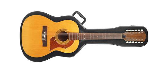 Musical instrument - Vintage twelve-string acoustic guitar from above on a hard case