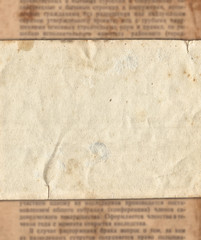 Vintage paper on old newspaper texture background