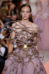 A model presents a creation by designer Elie Saab as part of his Haute Couture Fall/Winter 2018/2019 fashion show in Paris