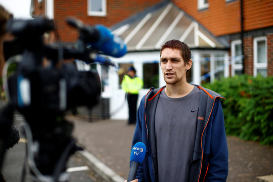 Sam Hobson, aged 29, talks to television crews outside Amesbury Baptist Church, after describing himself as a friend of the two people who were hospitalised, and as a result, police declared a 'major incident', in Amesbury