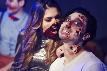 Creepy woman trying to bite her boyfriend at Halloween party