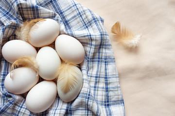 Fresh many duck eggs on Plaid fabric