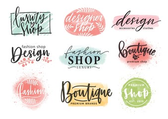 Collection of beautiful lettering hand drawn with elegant cursive font against colorful stains on background. Vector illustration for fashion boutique logo, apparel store or designer shop logotype. Wall mural