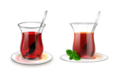 Turkish tea cup with black tea, silver spoon and mint