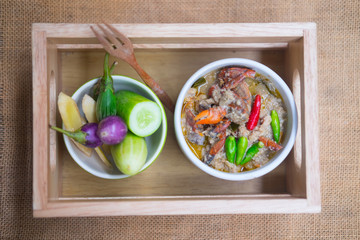 Soft crab boiled in coconut milk with fresh vegetables