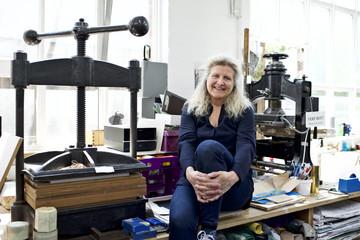 A female creative at work in her studio