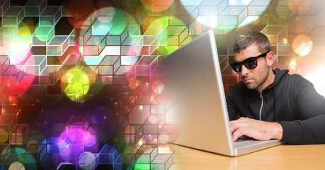 Man using computer with geometric transition