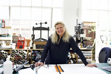 Portrait of mature woman in her workshop