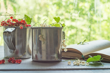 White and red currant in metal mugs