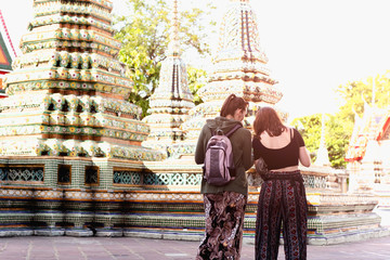 Unidentified tourist women visiting Thai temple back view in Bangkok