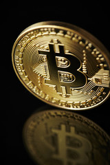 Cryptocurrency coins on black background