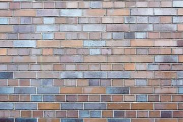 Red and grey grungy brick stone brick wall with dark gap