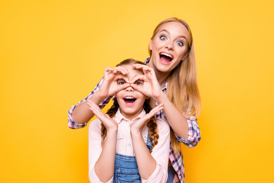 Joke positive emotion face facial expression adventure look health care concept. Portrait of two funky amazed shocked cute girls fooling around making eyeglasses with hands isolated bright background