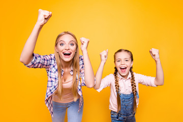 Yeah yes wow cool! Dreams come true! Different age face siblings mama mom mum mommy concept. Portrait of excited crazy joyful amazed cheerful girls with long hair isolated on bright vivid background