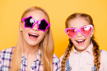 Weekend holiday different age two teen people concept. Close up portrait of funky rejoicing glamorous pretty careless kid with pink eye-wear nice girl with open mouth isolated on bright background